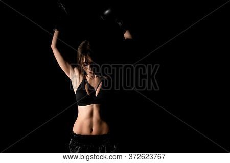 Female Boxer Training In The Dark Ring. Silhouette. Boxing Concept. Fighter Woman Fist Close Up. Sex