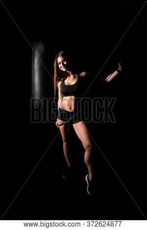 Young Fitness Woman Doing Exercise With Rubber Bands In Gym. Female Athlete Training At Exerciser In