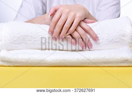 Beautiful Hands Of Young Woman Close-up On Towel. Spa Treatments For Nails. Space For Text. Woman Ho