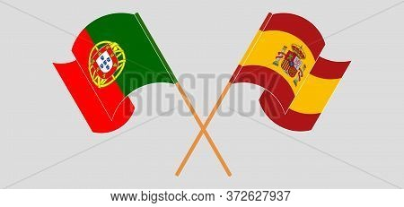 Crossed And Waving Flags Of Portugal And Spain. Vector Illustration