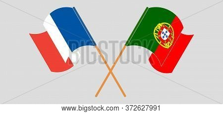 Crossed And Waving Flags Of Portugal And France. Vector Illustration