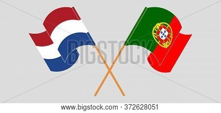 Crossed And Waving Flags Of Portugal And The Netherlands. Vector Illustration