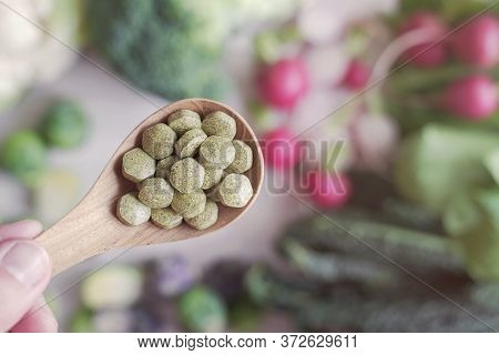 Cruciferous Vegetables Tablets In Wooden Spoon, Dietary Fiber Prebiotic Supplements For Healthy Gut