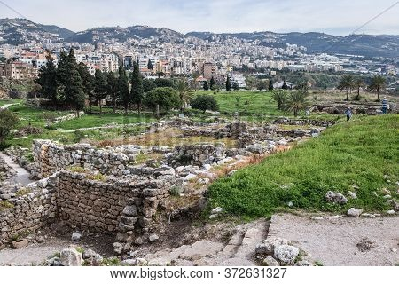 Ancient Ruins Next To Crusaders Fortress In Byblos, Lebanon, One Of The Oldest City In The World