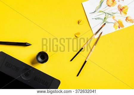 Top View Of Paintbrushes Near Drawn Flowers On Painting, Paper Cut Elements, Drawing Tablet And Styl