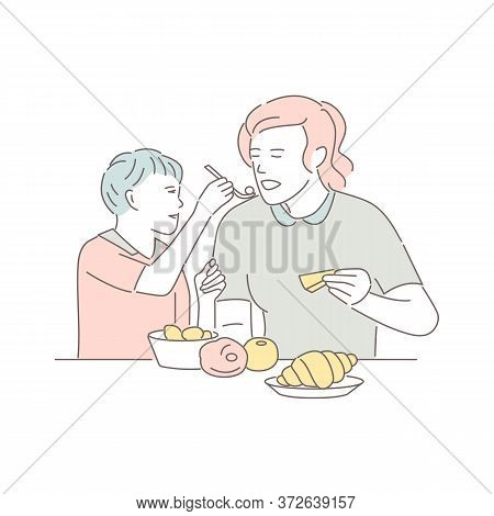 Mother And Son Sitting At The Table And Eating. Lovely Woman With Child Eats Dishes In Restaurant, I
