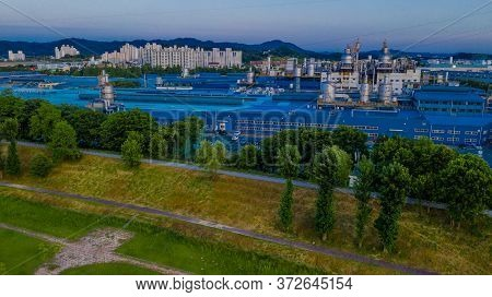 Sintanjin, South Korea; May 31, 2020: Aerial View Of Industrial Park At Edge Of Public Park With Hig