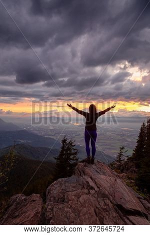 Adventurous Girl On Top Of A Rocky Mountain Overlooking The Beautiful Canadian Nature Landscape Duri