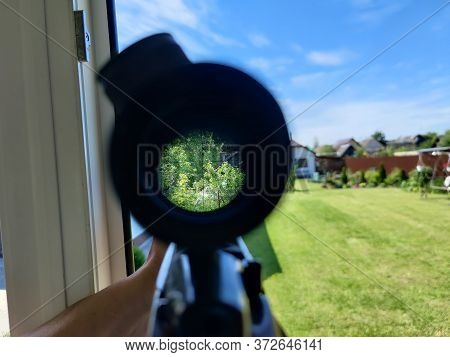 A Look Through An Optical Sight Aimed At A Group Of Potential Targets At The Range, Outdoor Shot.