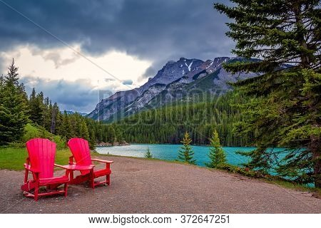 Adirondack Chairs Overlooking Mountains At Two Jack Lake