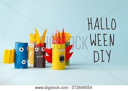 Halloween Diy Text Crafts, Paper Ghost, Monsters On Blue Paper Background. Halloween Concept Handcra