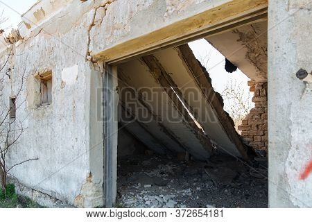 The Wall With The Doorway In The Ruins Of The Collapse Of The Devastation. Danger Of Collapse.