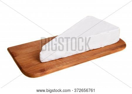 Feta (white) Cheese On Wooden Cutting Board