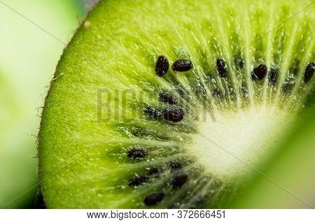 Juicy Kiwi Fruit Slice In Close-up With Macro Photography