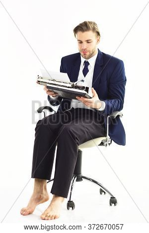 Workaholic, Hard Worker, Paper Work Concept. Young Businessman Works With Serious Face.