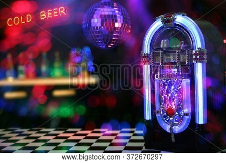 Jukebox In Bar With Neon Signs Photo Composite