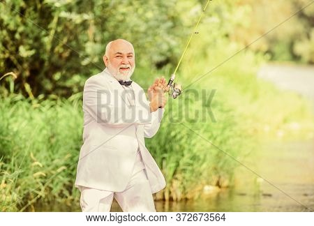 Retired Businessman. Good Profit. Hobby And Recreation. Fishermen In Formal Suit. Successful Catch.