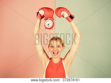 Boxer Fighting With Alarm Clock. Time For Boxing Training. Punctuality And Personal Efficiency. Cont