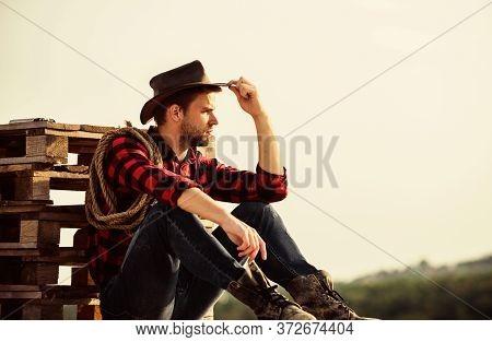 A True Cowboy. Vintage Style Man. Wild West Retro Cowboy. Wild West Rodeo. Thoughtful Man In Hat Rel