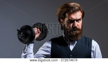 He Is Strong. Brutal Mature Hipster In Suit With Dumbbell. Business And Sport. Express Real Power. B