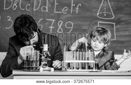 Touching Lives Forever. Father And Son At School. Teacher Man With Little Boy. School Lab Equipment.