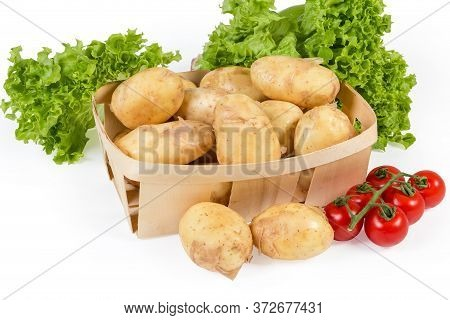 Raw Washed Yellow Young Potatoes With Unpeeled Thin Skin In The Small Wooden Basket And Beside, Cher
