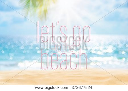 Let's Go To The Beach Words On Blur Tropical Beach With Bokeh Sunlight Wave Abstract Background.
