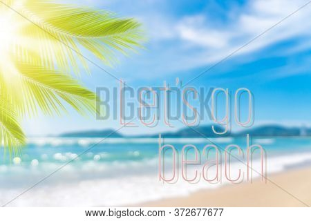 Let's Go Beach Words On Blur Tropical Beach With Bokeh Sunlight Wave Abstract Background. Summer Vac