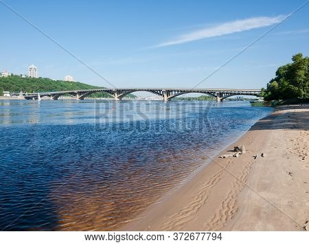 Metro-automobile Arch Concrete Bridge Over The River In Springtime. Metro Bridge Across Dnieper Rive