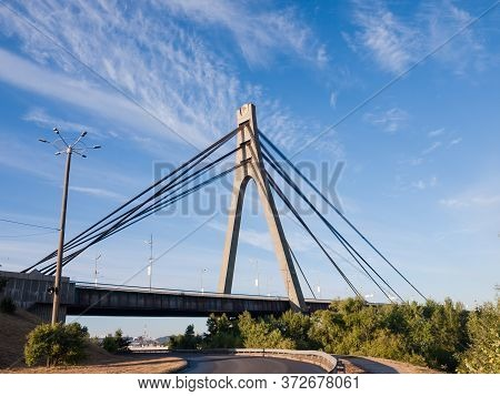 Part Of The Cable-stayed Bridge With Concrete Pylon And Steel Ropes, Bottom View Against The Sky Wit