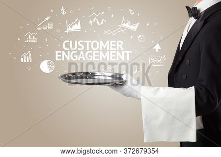 Waiter serving business idea concept with CUSTOMER ENGAGEMENT inscription