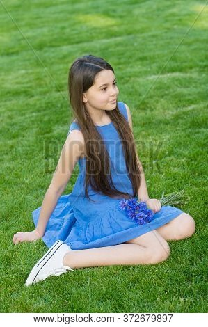 Nature Vacation. Little Girl Sit On Green Grass. Small Child In Casual Style. Summer Vacation. Enjoy