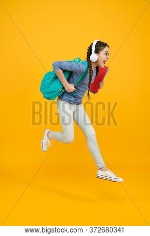 Chase Your Dream. Energetic Kid Hurry To School. Happy Child In Energetic Jump Yellow Background. En