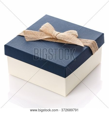 Square Gift Box With Blue Lid And Burlap Ribbon Bow. Isolated On White.