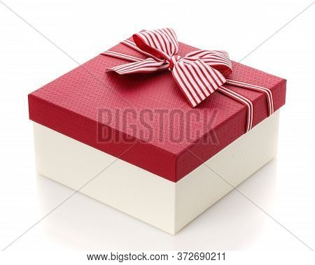Burgundy Gift Box With A Beautiful Bow On A White Background.