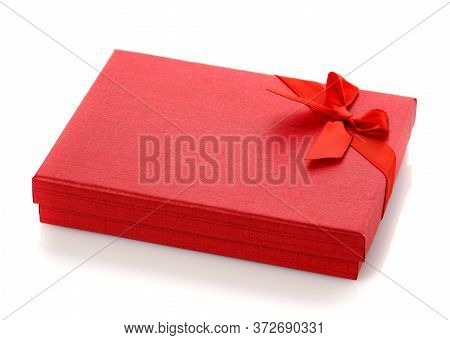 Elegant Red Gift Box With A Small Bow. Isolated.