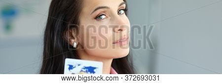 Confident Beautiful Woman Holds Bank Credit Card. Transaction Control, System Setup, Analysis And Up