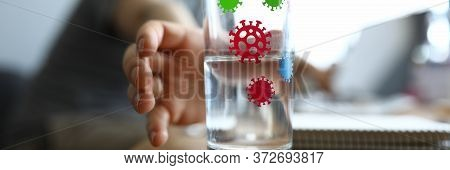 Hand Reaches For Glass Infected With Coronavirus. Acute Respiratory Infection With All Their Charact