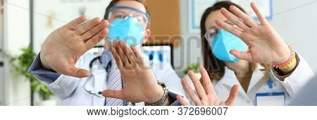 Male And Female Doctors Examined Protective Masks. Doctors Worry About Possibility Becoming Infected