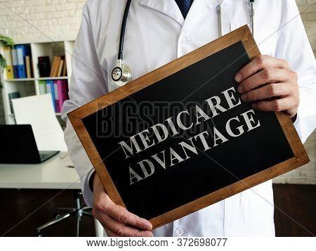 A Doctor Shows A Tablet Medicare Advantage.