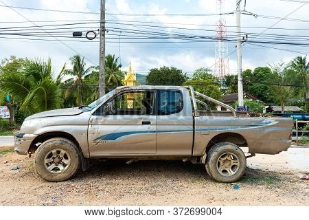 Old Battered Pickup Truck Parked Near The House. Rural Transport. Samui / Tailand - 02.24.2020