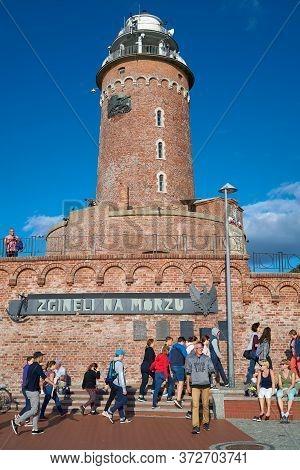 Kolobrzeg, Poland - September 06, 2019: Tourists At The Kolobrzeg Lighthouse On The Polish Baltic Se