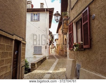 A Typical Street Of Cannobio Small Town At The Shores Of The Lago Maggiore By Day, Piedmont, Italy,