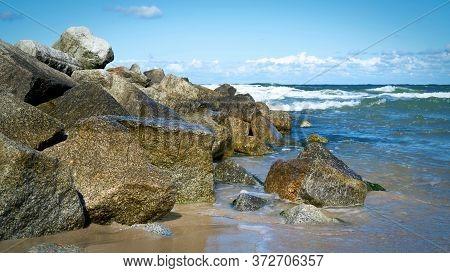 Boulders As Breakwaters On The Beach Of Niechorze On The Polish Baltic Sea Coast