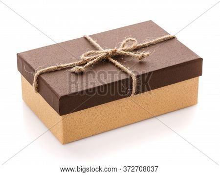 Cardboard Box On A White Background. Gift Box With Sacking Ribbon.
