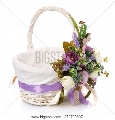 White Wicker Basket With Floral Decoration, Decorative Wooden Bunny And Ribbons On White Background.