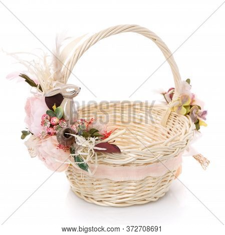 Wicker Basket Of Natural Vines With Floral Decor And Ribbons On White Background. The Basket Decor I