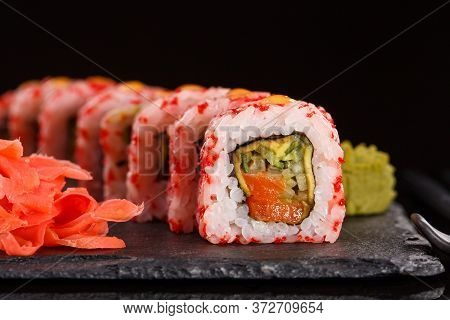 Roll With Red Caviar Of Fresh Salmon, Cream Cheese, Cucumber, Avocado. Served With Ginger And Wasabi