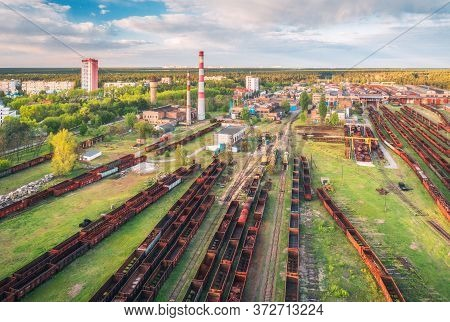 Aerial View Of Freight Trains. Railway Station With Wagons. Heavy Industry. Industrial Landscape Wit