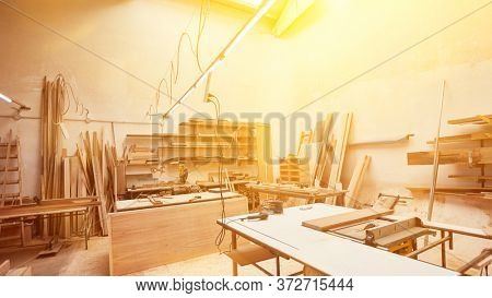 Workshop of a joinery with wood and tools and workbenches